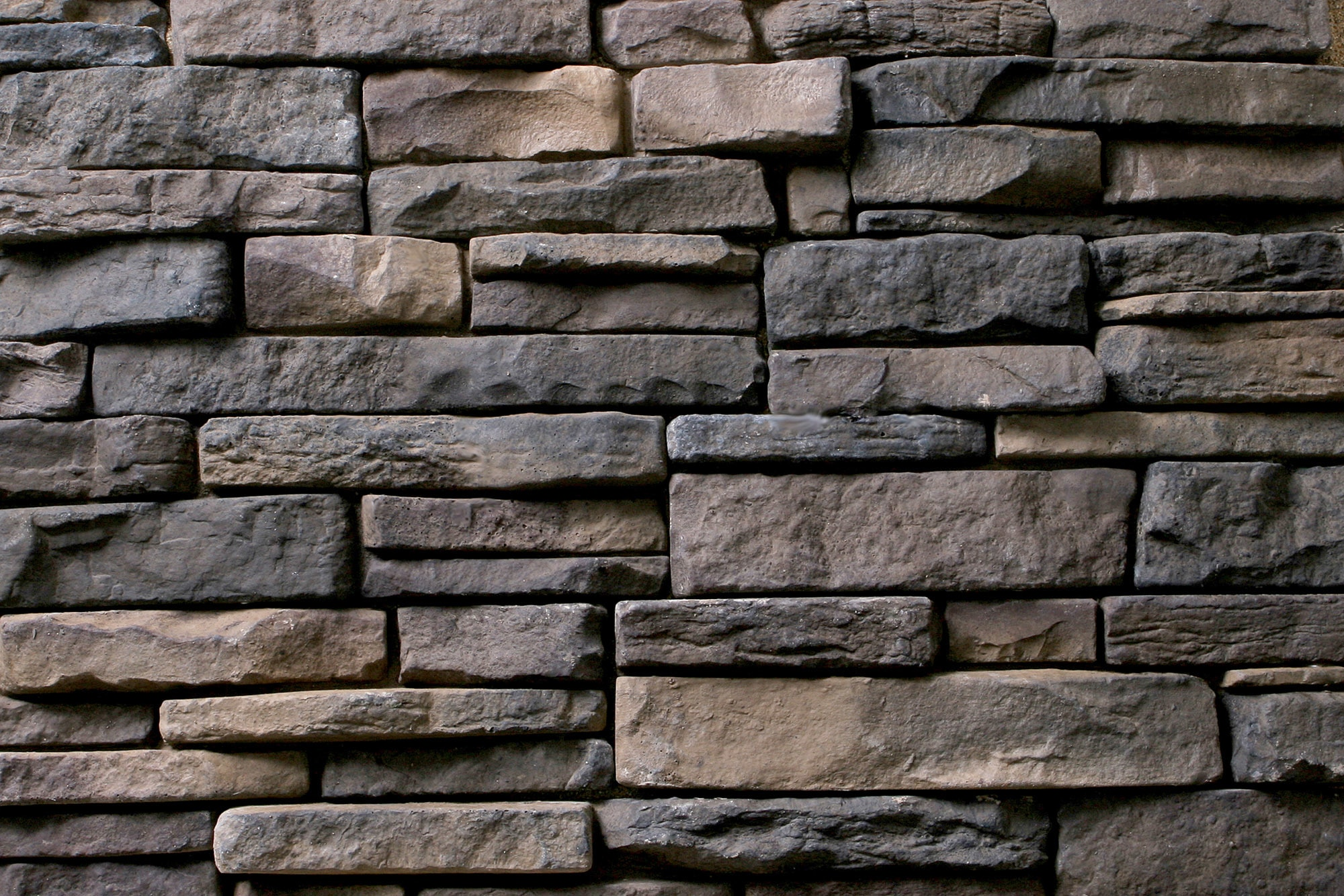 Stone veneer siding howtoword design ideas for Stone facade siding